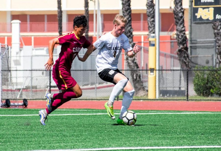 Cal State LA midfielder, Tim Klefisch, fends off Toro, Julian Guerrero during their game against Cal State Dominguez Hills at Cal State LA.