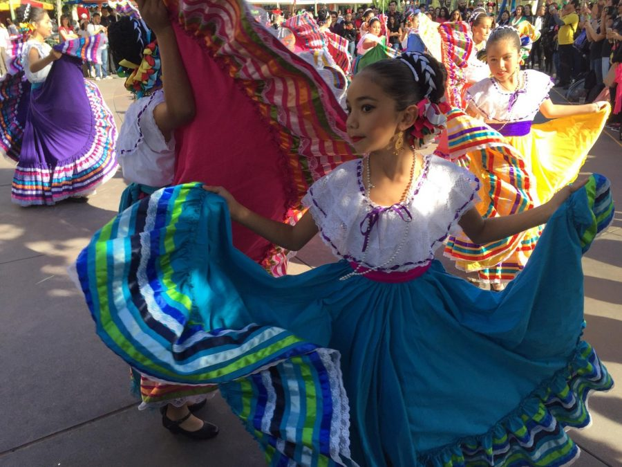 Children dancing with Hispanic Culture dresses.