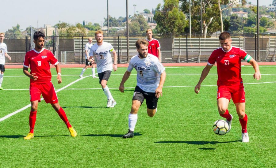 Cal State LA soccer player is aiming for the ball as the Concordia Eagles are playing offensively