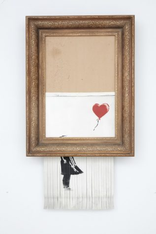 Bansky new picture is destroyed as it's being auctioned in an open gallery