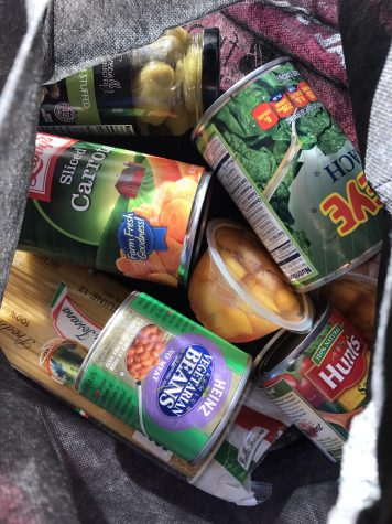 Picture of Cal State LA Fresh bag filled with carrots, beans, and other canned food essentials.