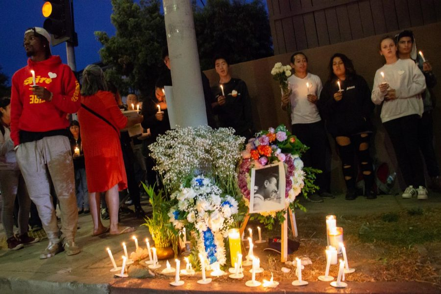 Family and friends of Andy Olivera gather on the corner of 1st Street and Virgil in downtown, LA to honor the passing of Olivera, a member of their community