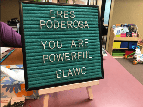 "A sign which is stating ""Eres Poderosa: You are powerful: ELAWC"""