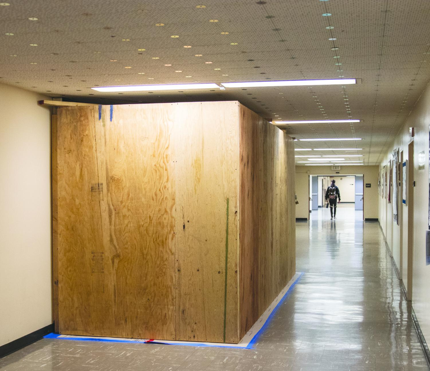 King Hall elevator maintenance obstructing a large portion of the hallway in all five levels of the building