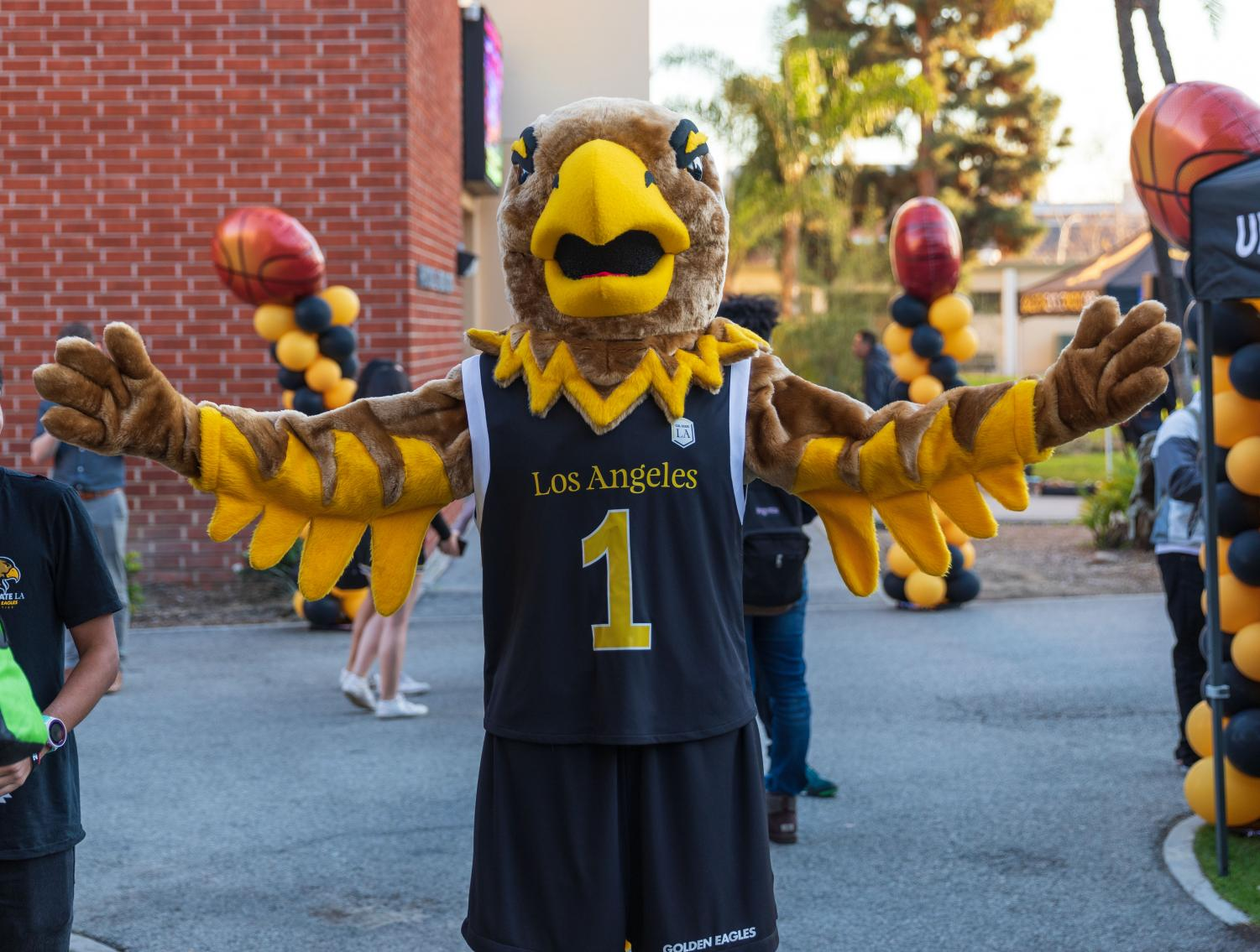 Eddie the Eagle, Cal State LA's mascot, poses for a photo in front of the Eagle's Nest Gym.