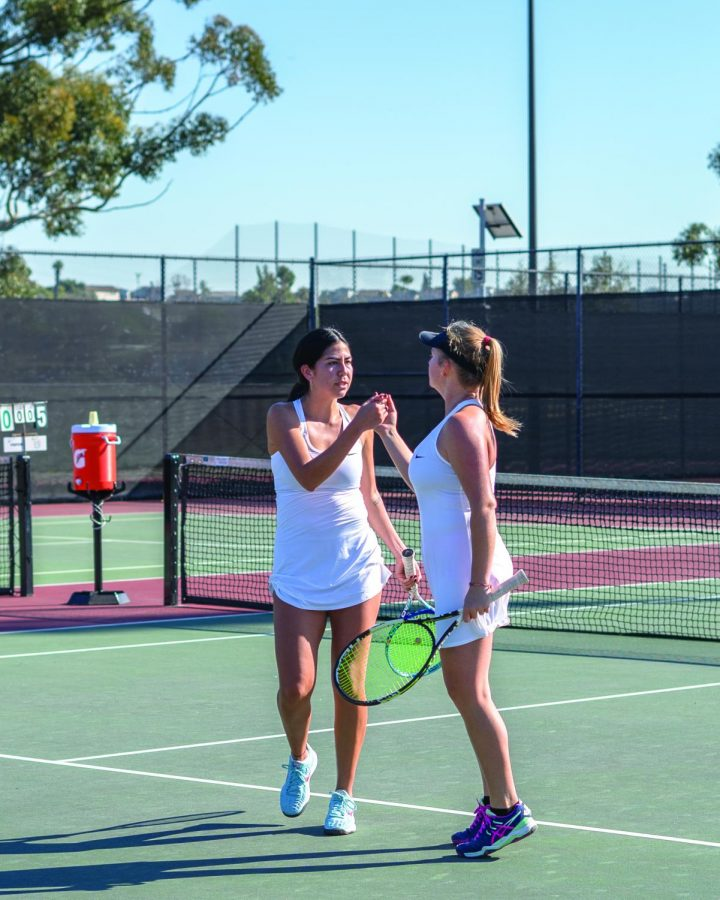 Laura (right) and Lopez (left) hyping each other up before next match.