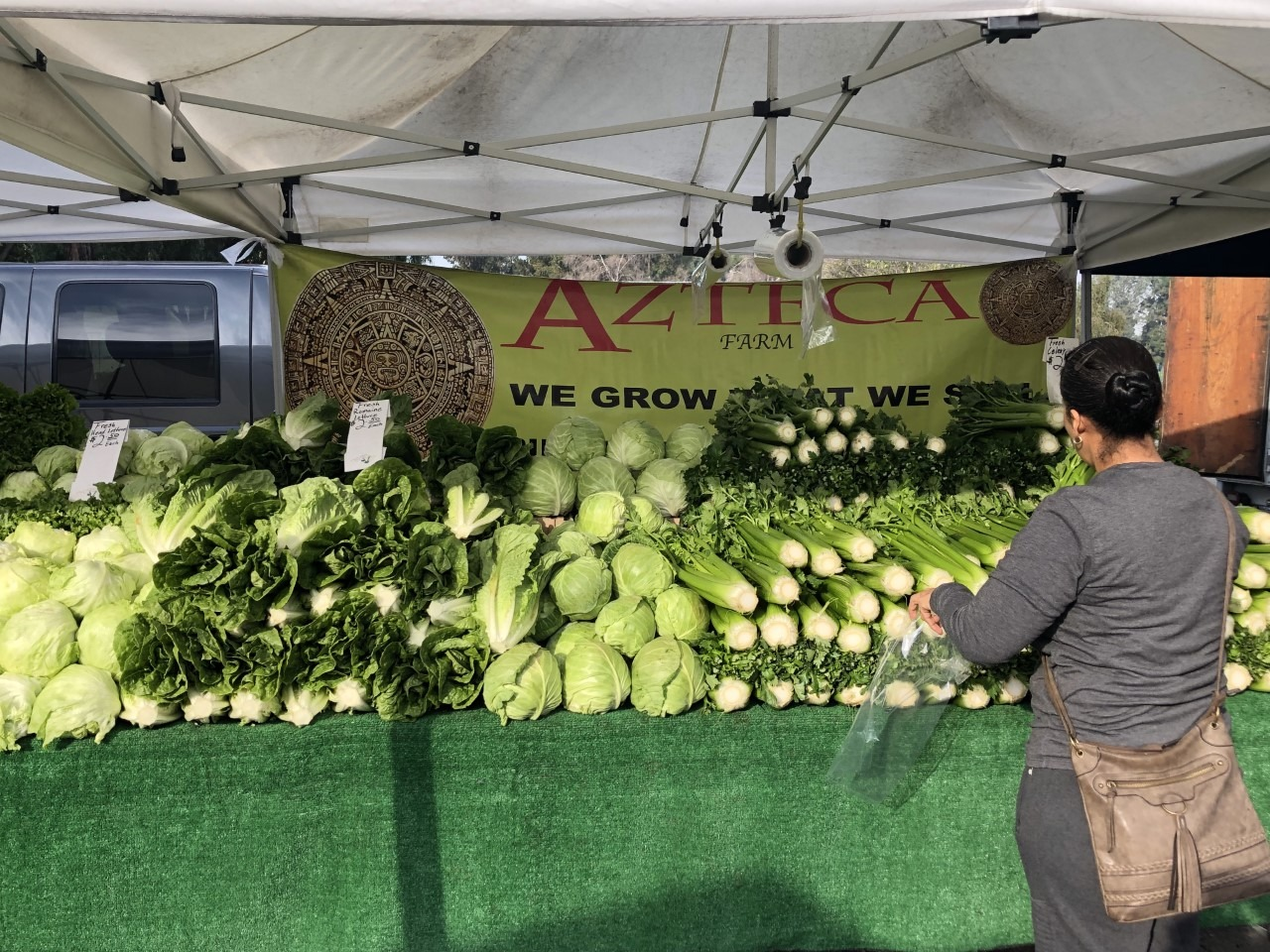 A customer shops at a farmers' market in Huntington Park. (Joshua Letona/Community News)