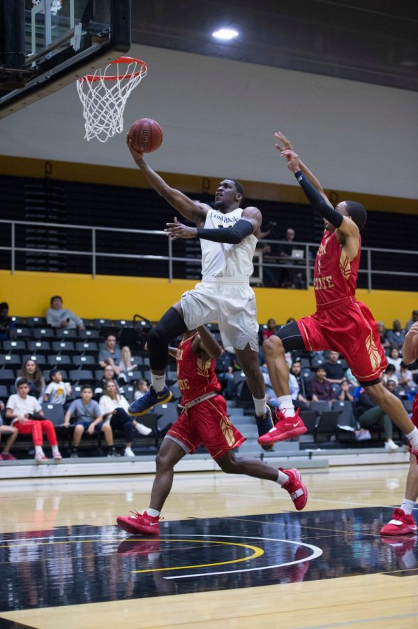 Cal state la mens basketball is playing on the court.