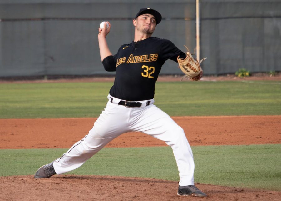 Pitcher is pitching the ball as Cal State LA men's baseball loses its first game against Cal Poly Pomona 11-7.