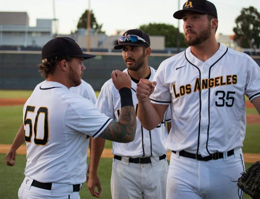 Austin Nazabal (35) is greeted by his teammate, Jackson Bond (50) after his start against the UCSD Tritons on Thursday.