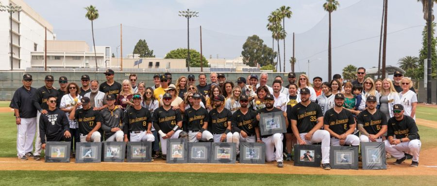 Group picture of the graduating seniors with their friends and families as well as the baseball staff on Senior Day at the Reeder Field.