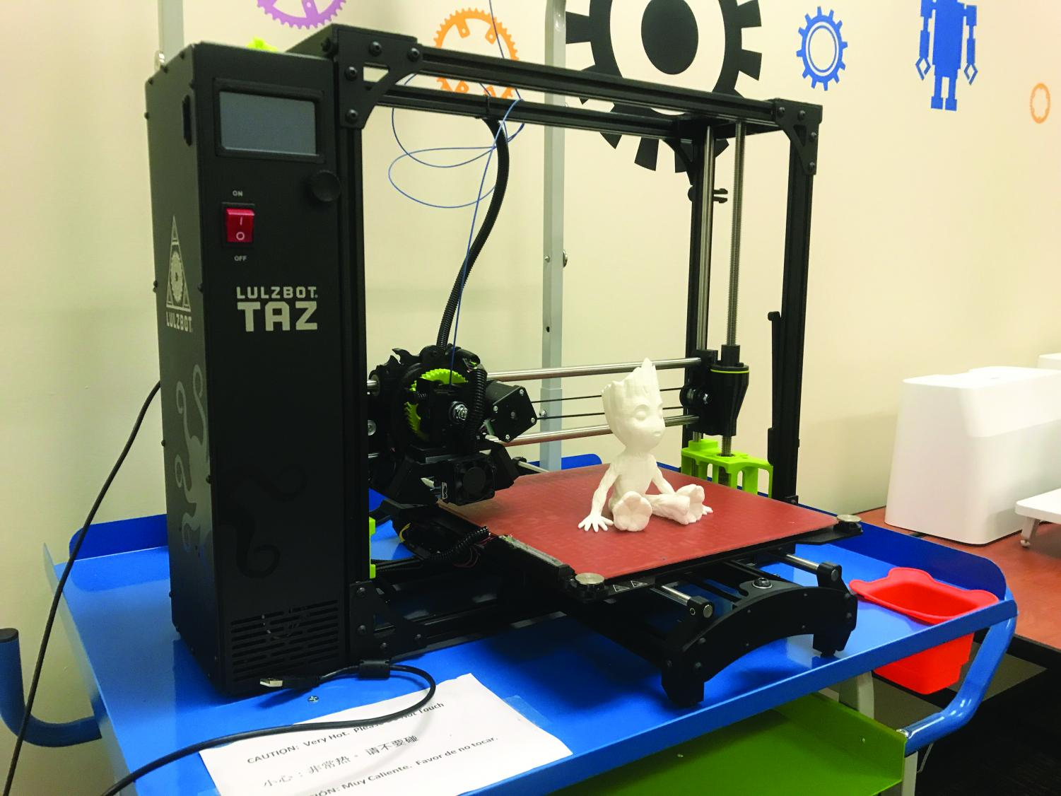 A Groot figurine sits on the 3D printer that created it. (Daniel Lindley/UT)