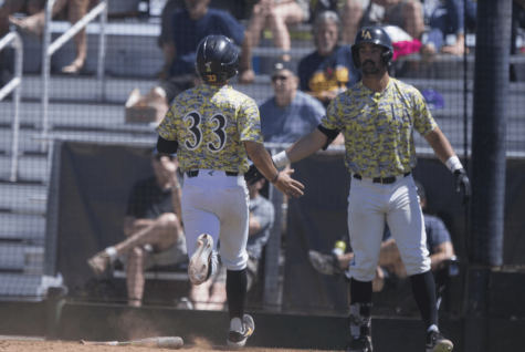 Golden Eagles' designated hitter, (33) Nic Sandoval (left) is greeted by teammate, (29) Adam Gordon (right) after scoring on an RBI single by Tyler Odekirk. Photo courtesy of Cal State LA Athletics Department