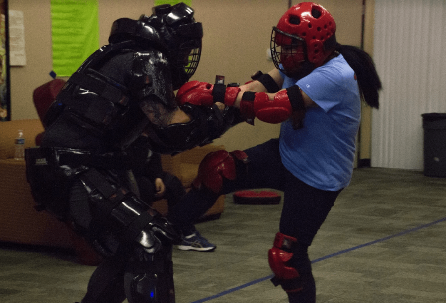 The final session includes a simulation for R.A.D. students to practice their techniques on. The male instructors dress in protective gear as the female students fight off their aggressors.