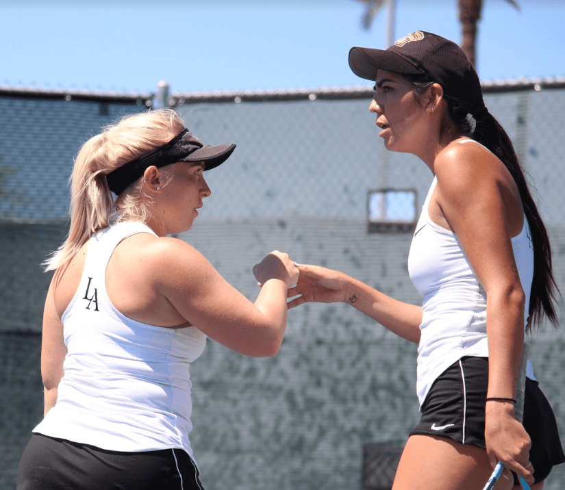 Golden Eagles' Amanda Schneider (left) and Isabella Lopez (right) clinched the first point for their team in a 6-4 win against Point Loma's Gabi Armas and Ellie Gamble in the 5th Place Match of the PacWest Conference Championship. Photo courtesy of PacWest Conference