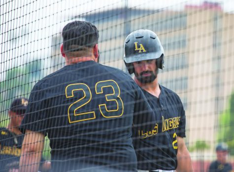 After finishing eighth in the conference this season, the Golden Eagles will miss the playoffs for the first time since 2016. Pictured: (left) third baseman Anthony Moreno (23) and (right) right fielder Adam Gordon (29) meet at home plate.