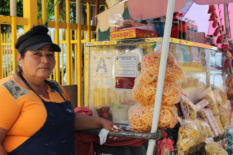 A portrait of Oralia Figueroa Castaneda and her fruit stand.