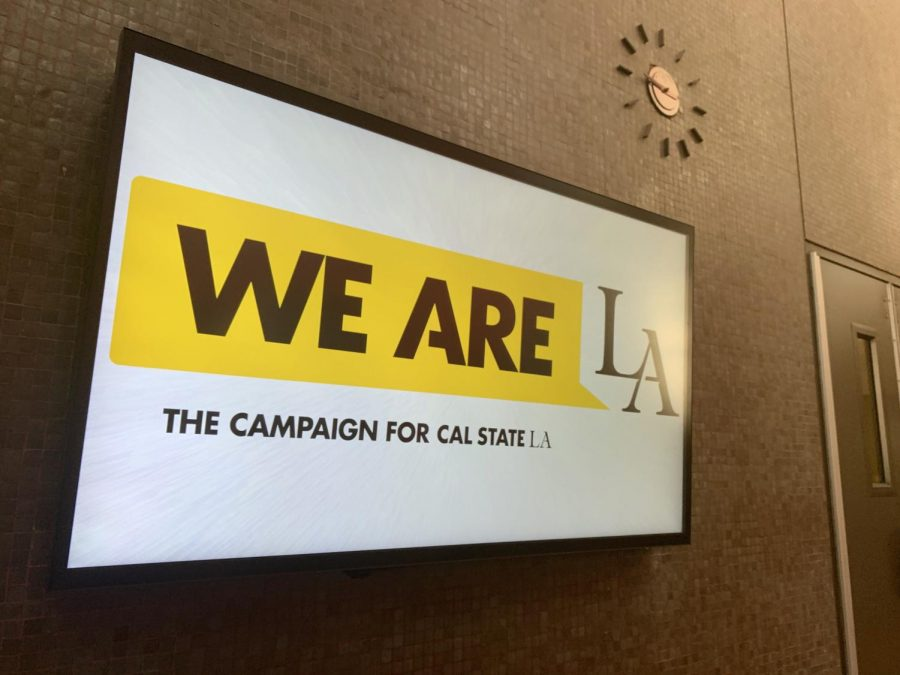 The We are LA logo runs on a monitor at the Cal State LA's Administrative building ground floor. The fundraising campaign's goal is to reach $75 million that is to be allocated throughout the university's departments. It is now at $61 million and hopes to surpass its goal by next year