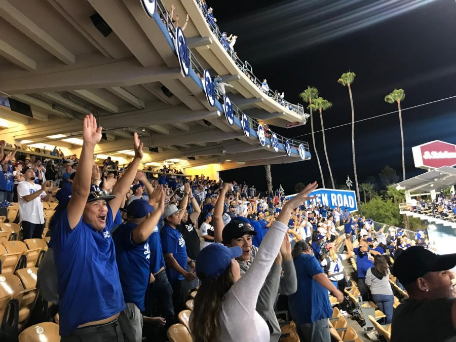 The+crowd+cheers+with+excitement+as+Max+Muncy+and+Cody+Bellinger+score+to+tie+the+game+during+the+ninth+inning.+