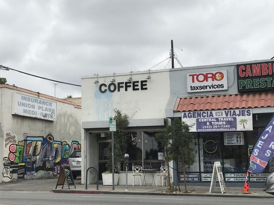 Blue paint splattered on Weird Wave Coffee Brewers on Cesar E. Chavez Avenue is still visible. Photo by Meghan Bravo.