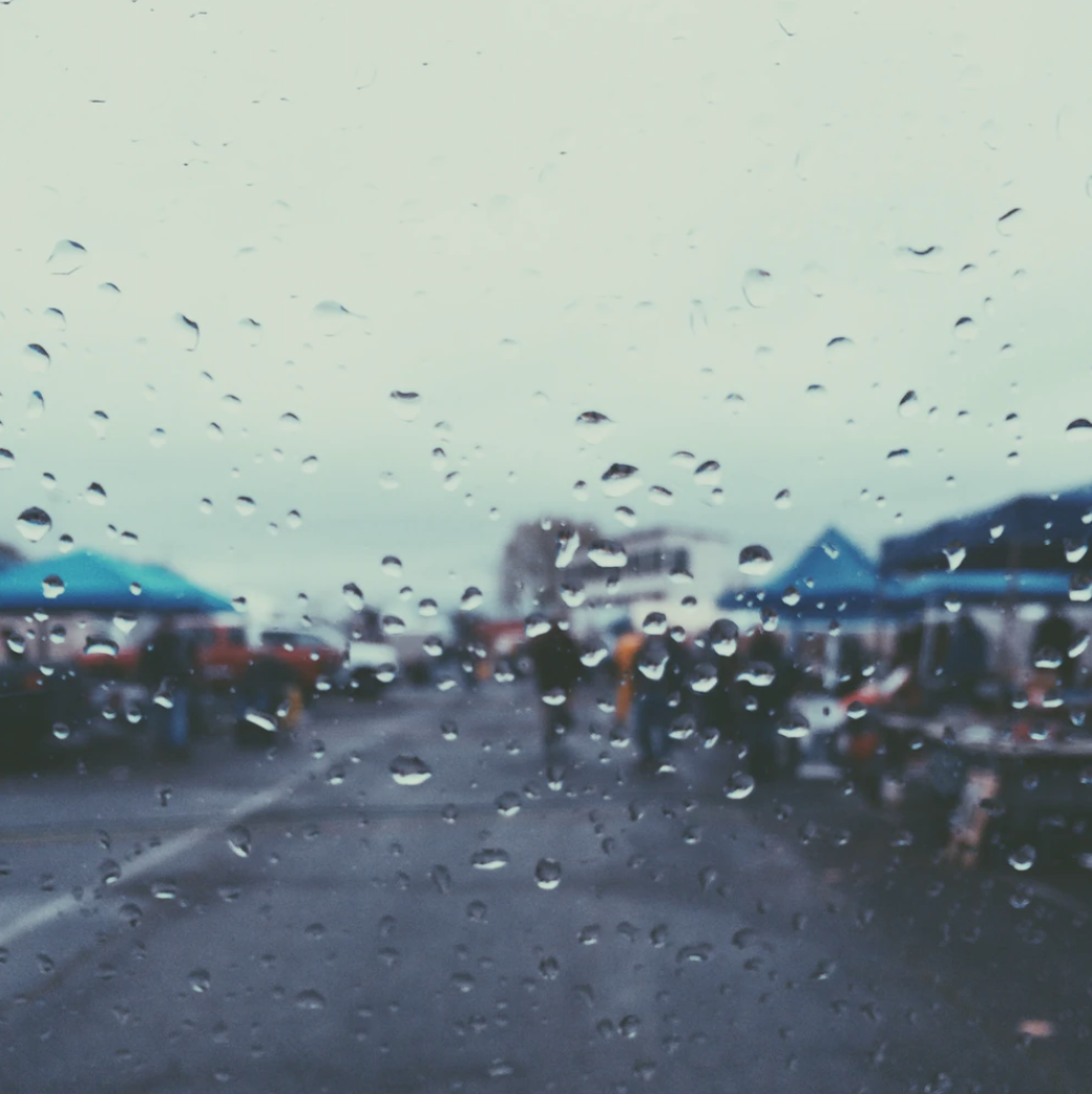 Photo of rain drops and booths by Ryan Wilson, @rbwilson, via Unsplash