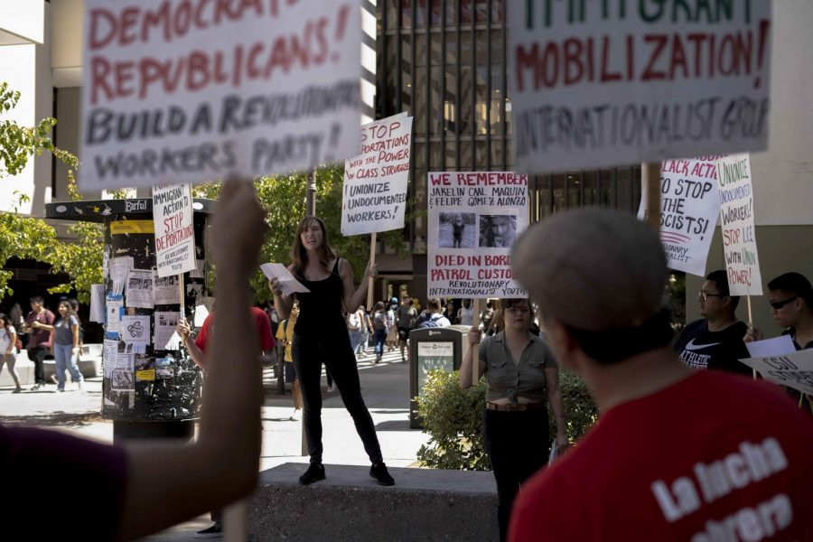 Viviana Capitran (middle left) speaking at a rally against I.C.E. raids, which was hosted by the Revolutionary Internationalist Youth organization last Thursday at Cal State LA near the Golden Eagle statue.