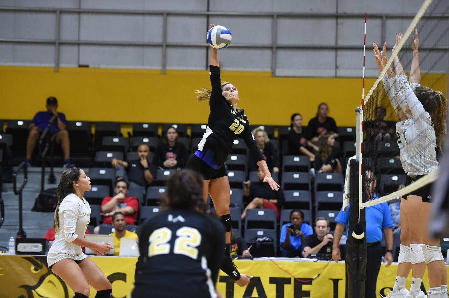 Alejandra Negron (20) hits the volleyball back towards the opposing side of the court. Cal State LA women's volleyball team won against Hawaii Pacific in a home game of 3-0.