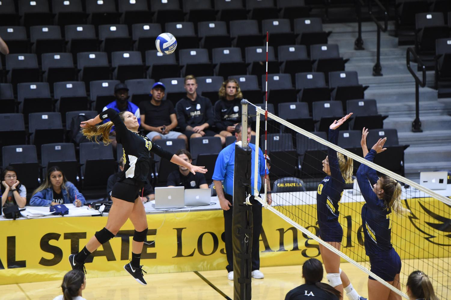 Alejandra Negron (20) reaches to hit the ball. The Cal State LA women's volleyball team defeated UC San Diego with a score of 3-0.