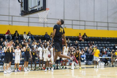David Williams flys high for a dunk.