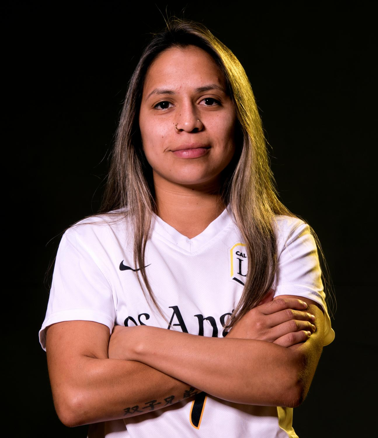 Headshot of Kimberly Surio. Surio has been playing soccer throughout high school and college.