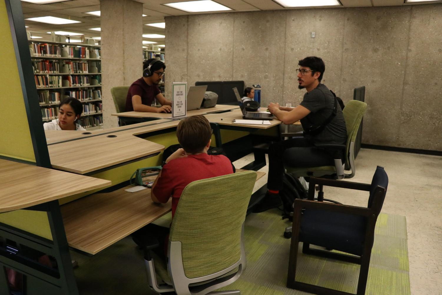 New multilevel desks are tested by students in the north library, allowing for students to sit in different ways depending on what they find comfortable.