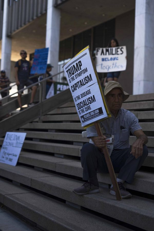 Resting at the steps of the US General Services Administration building in Los Angeles, protestors ended their march with speeches, signs, and chants against ICE deportations.