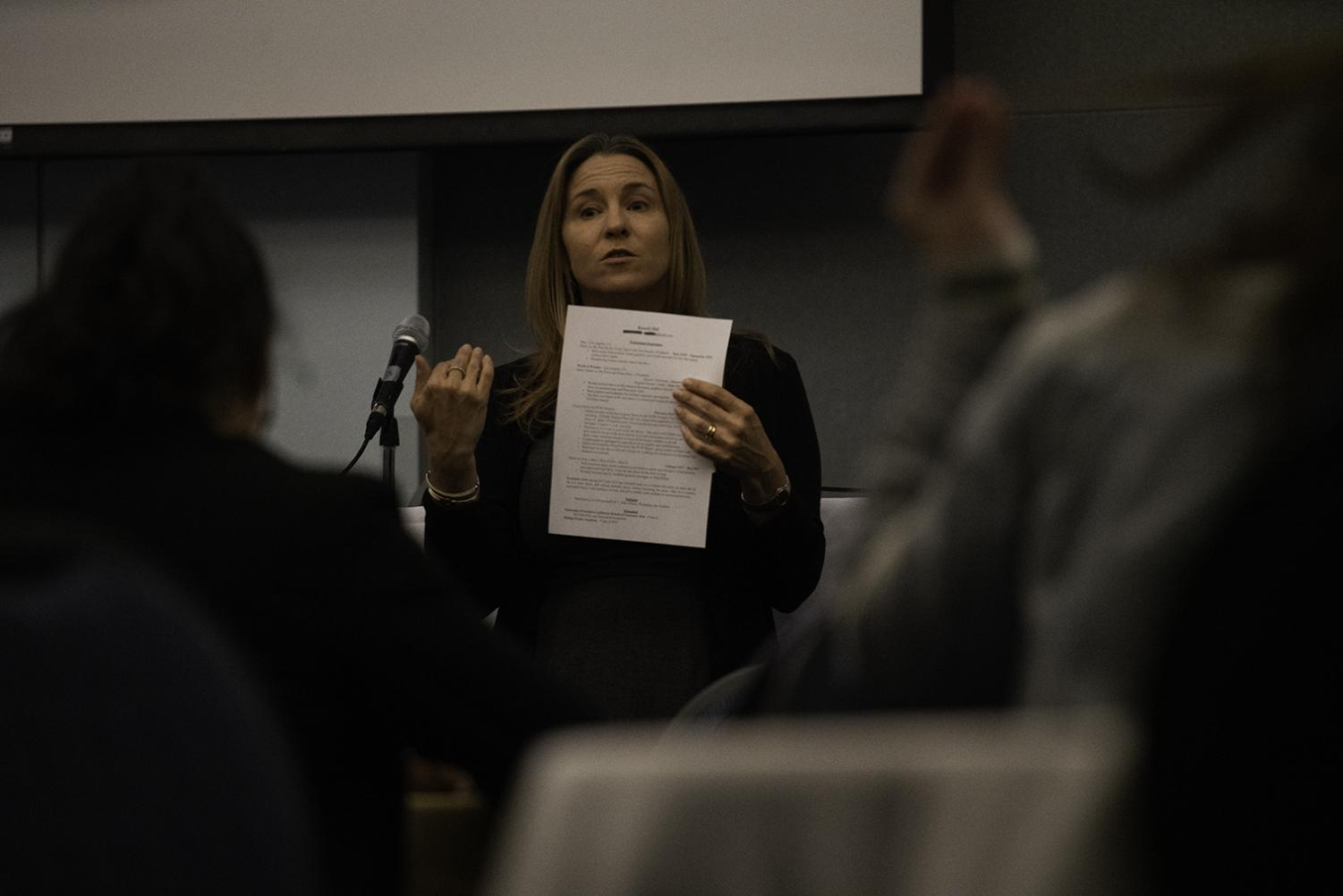 Nina O' Brien, the associate professor of Communication Studies and Management of Cal State LA, goes over a resume workshop at the Connect the Dots event.