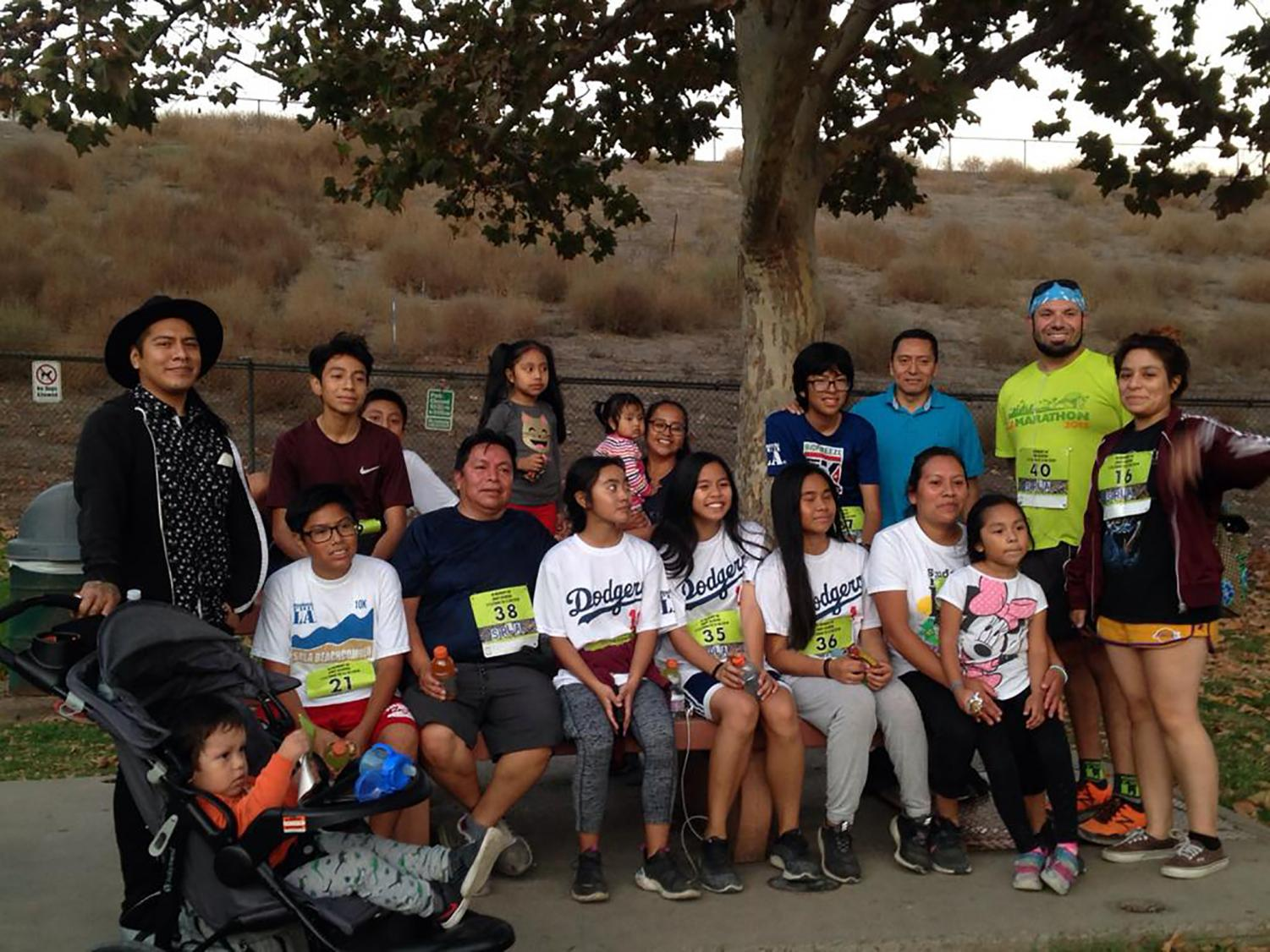 A group photo of everyone who participated in the run is shared. Before the vigil, everyone honored Andy by participating in one of his favorite activities, running.