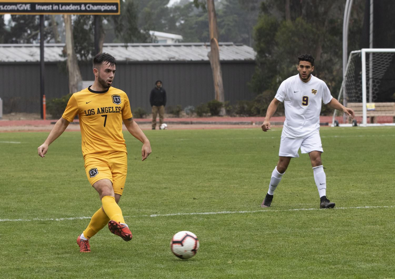 Daniel Simonis (7) kicks the ball towards the goal.