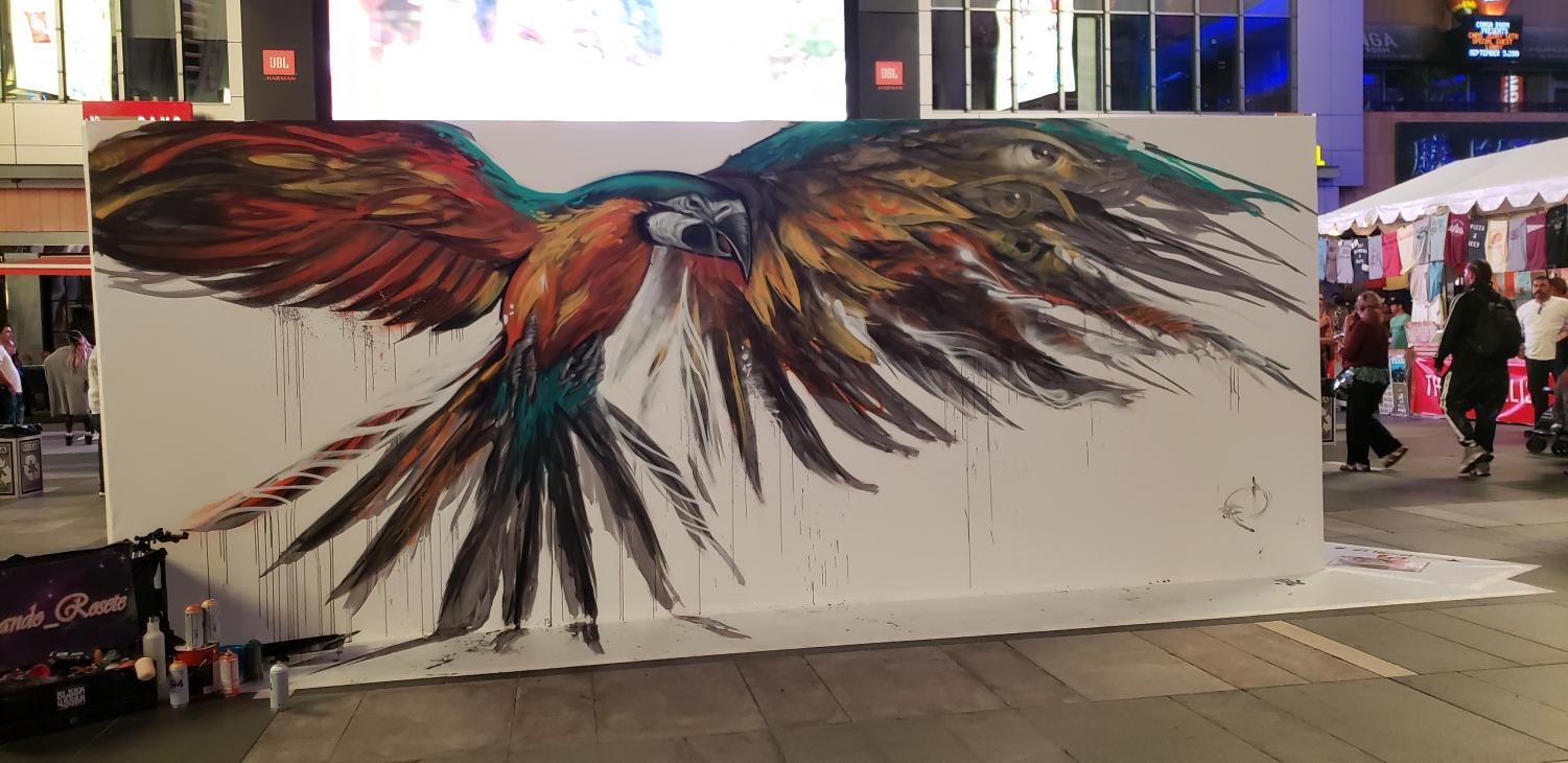 A painting of a colorful parrot with its wings spread open.
