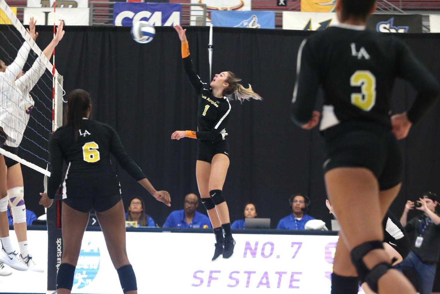 Julia Azevedo (1) hits the ball over the net on Thursday's volleyball tournament game against San Francisco State.