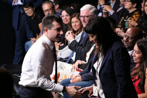 Mayor Pete Guttigieg is shown shaking hands at the presidential candidates forum on campus.
