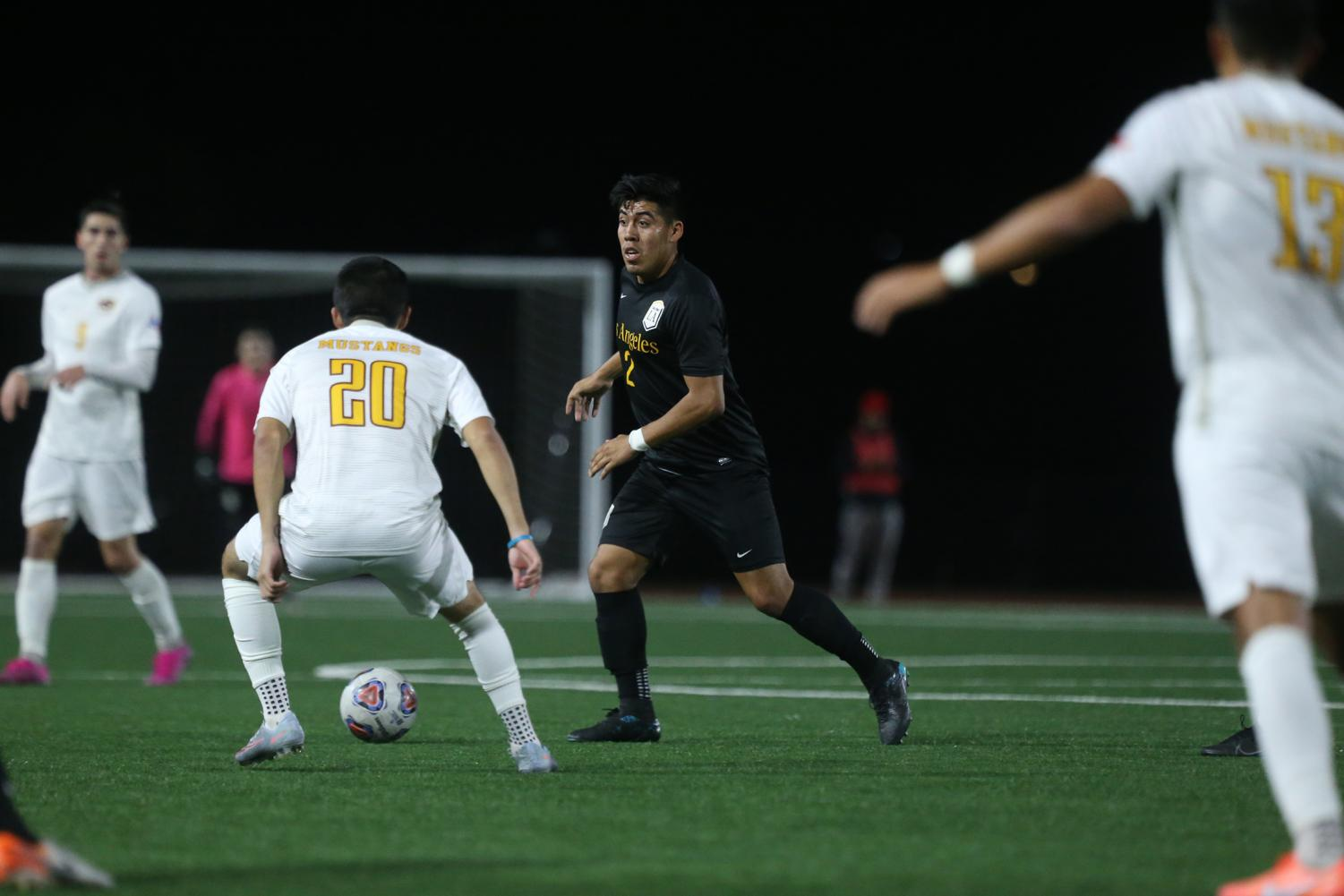 Carlos Zarate (2) goes in for the ball at the Cal State LA men's soccer game against Midwestern State.