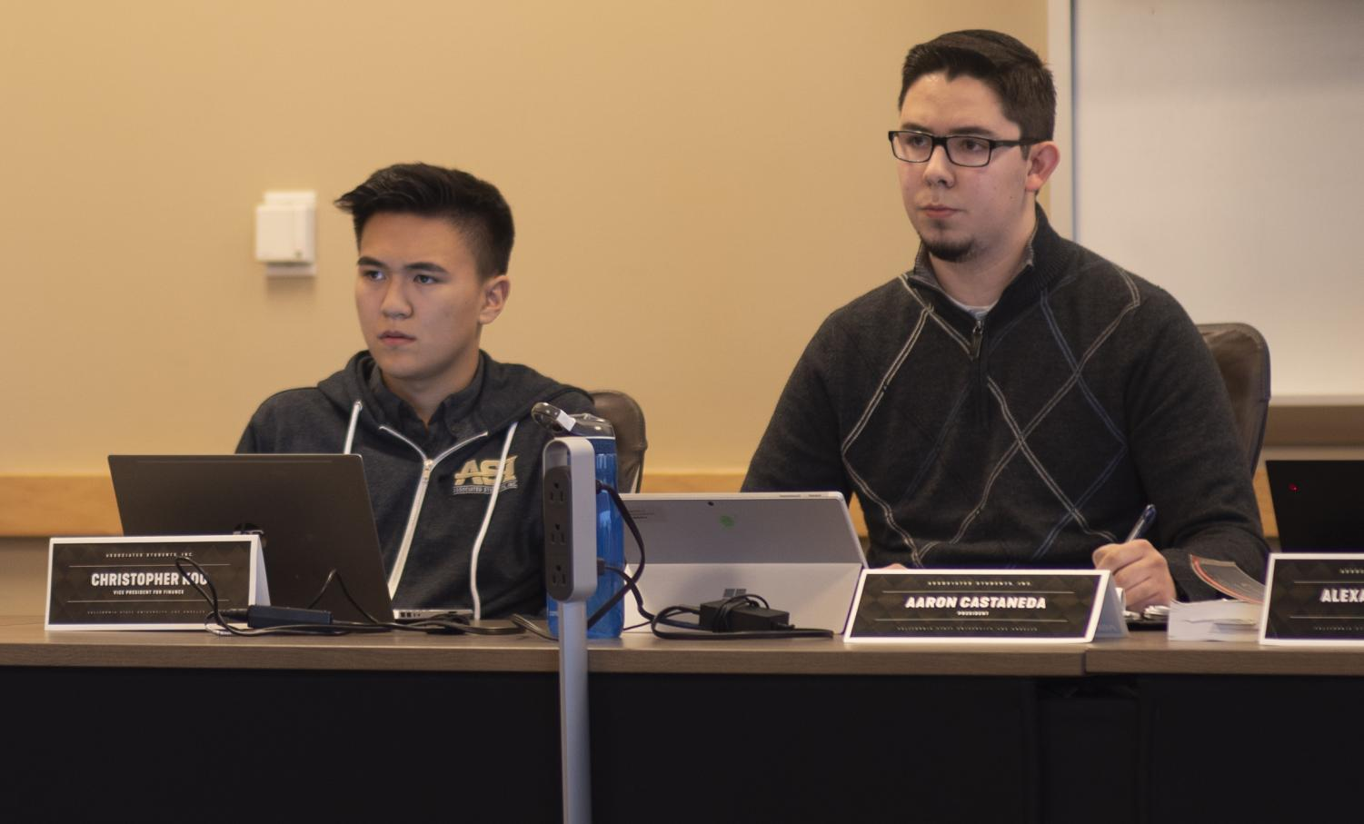 Christopher Koo (left) and Aaron Castaneda (right) listen to Cal State LA community members during a Board Members meeting on Nov. 14.