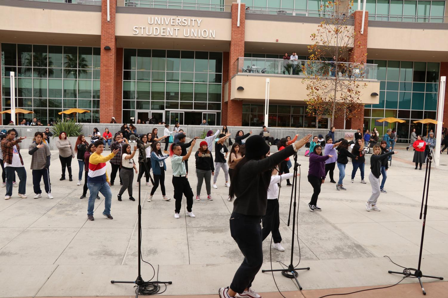 Step-by-step dance lessons are taught to those attending the K-pop dance workshop on campus.