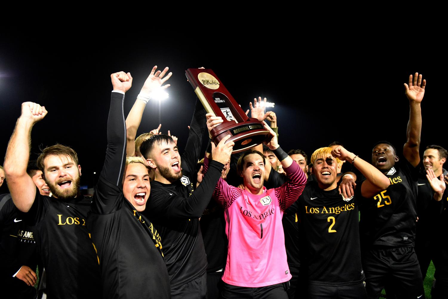 Cal State LA men's soccer team celebrate winning the NCAA quarterfinals with their own trophy. Cal State LA will transition to the NCAA Championship semifinal in Pittsburgh, Pennsylvania.