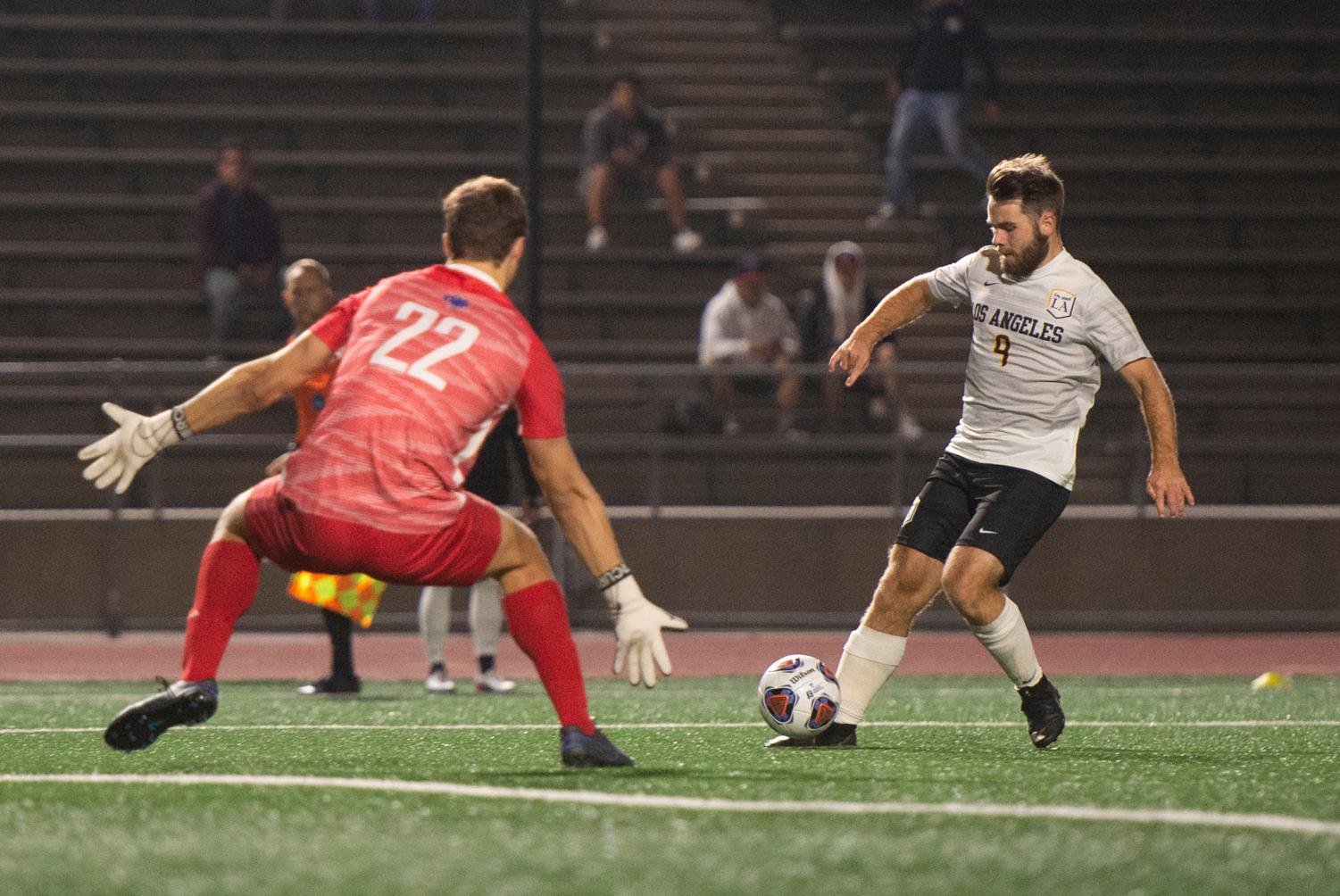 Robin Lindahl (9) defends the ball against his opponent.
