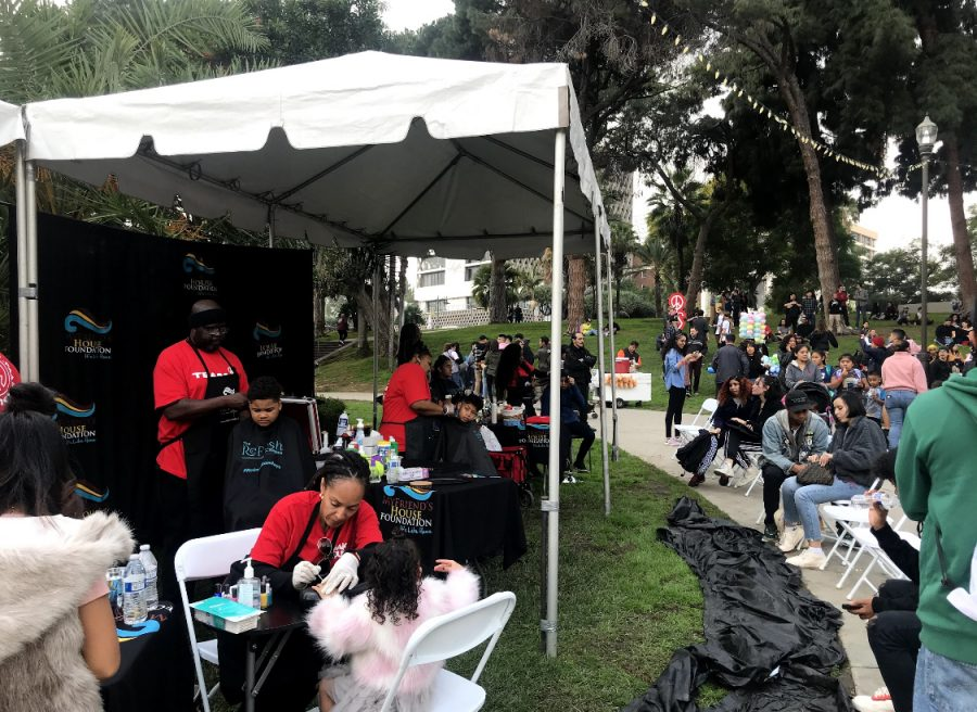Community members and children received haircuts and manicures offered by the Brandon Anderson Foundation during the event.