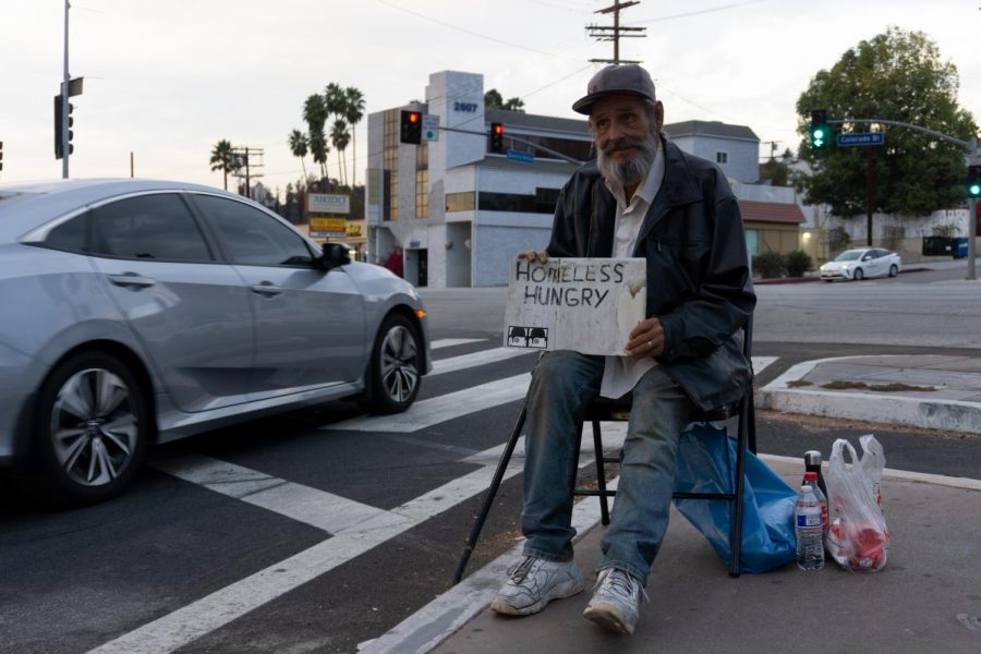 Larry+McCarter%2C+who+says+he%27s+been+homeless+for+10+years%2C+sits+on+Sierra+Villa+Drive+and+Colorado+Boulevard%2C+asking+for+donations.