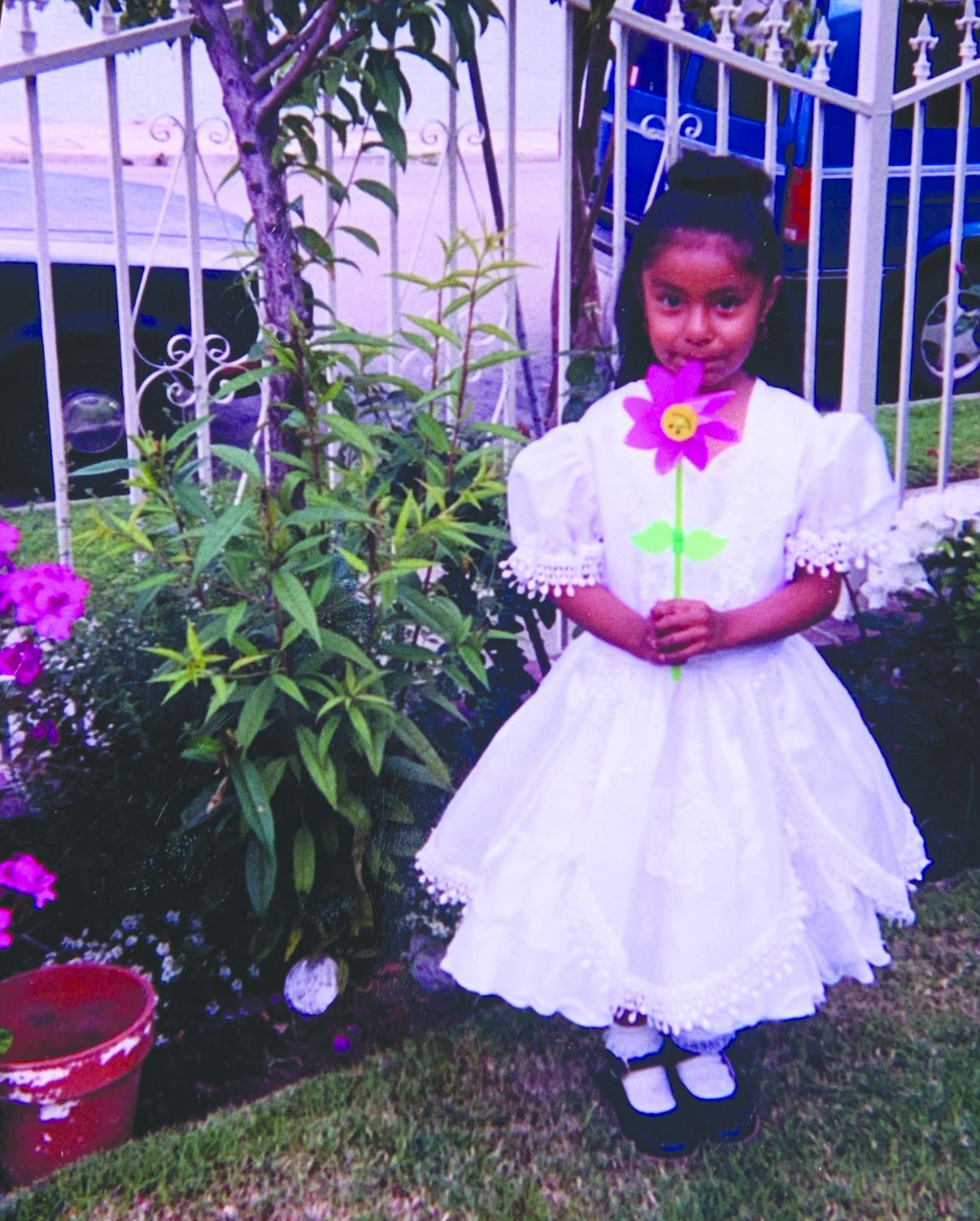Rosio Flores was dressed in white at age 3 in South Central L.A. on the day of her presentación, a religious ceremony.