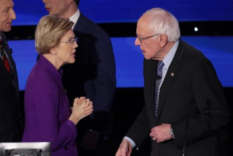 Sen. Elizabeth Warren (left) and Sen. Bernie Sanders (right) privately speak after the Democratic presidential primary debate on January 14, 2020.