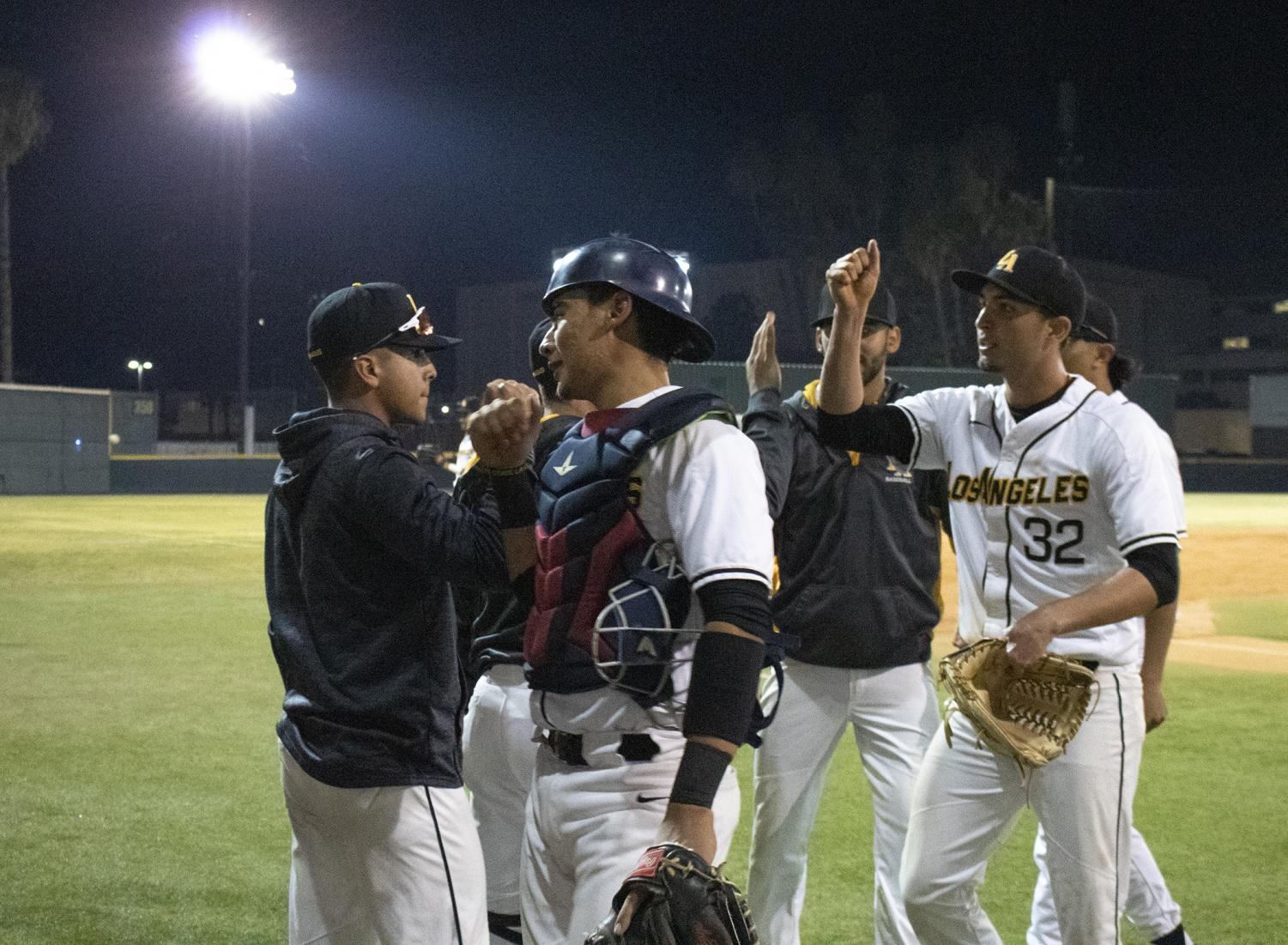 The baseball team celebrates a victory at the second game this past Friday against Northwest Nazarene