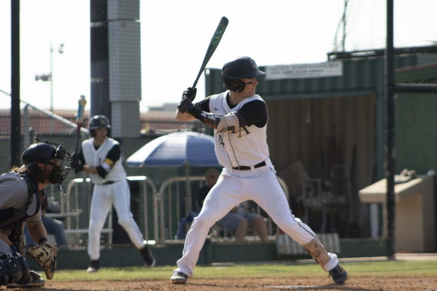 Cal State LA's Shortstop, Tyler Odekirk, (14) in his batting stance awaiting the next pitch