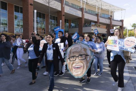 As part of a Sanders campaign event, campus community members gathered in support of the self-labeled democratic socialist, marching from the USU plaza to nearby the voting center on campus.
